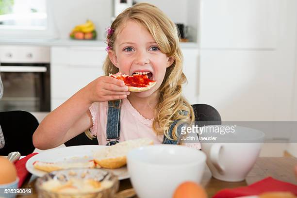 Girl eating at kitchen table