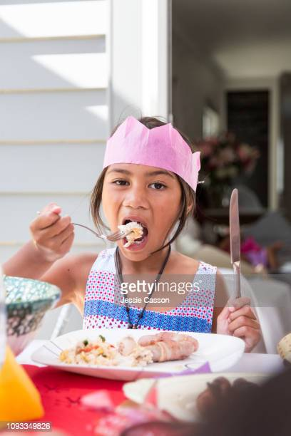 Girl eating at outdoor Christmas lunch table