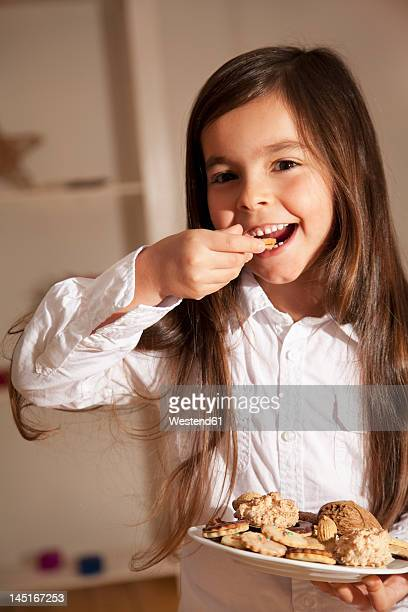 Girl eating biscuit, close up