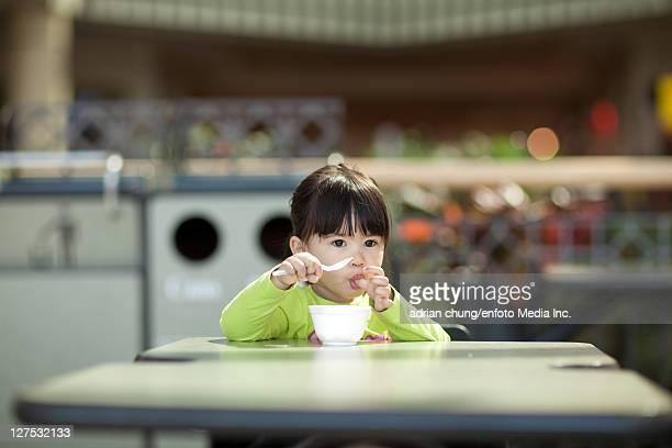Girl eating bowl of ice cream