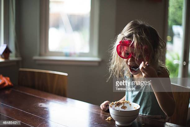 Girl Eating Cereal with Goggles On
