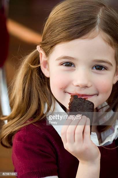 Girl eating chocolate cake