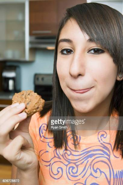 Girl eating chocolate chip cookie