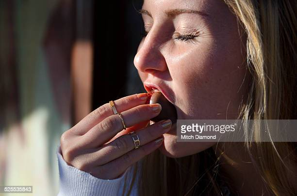 girl eating chocolate covered strawberry