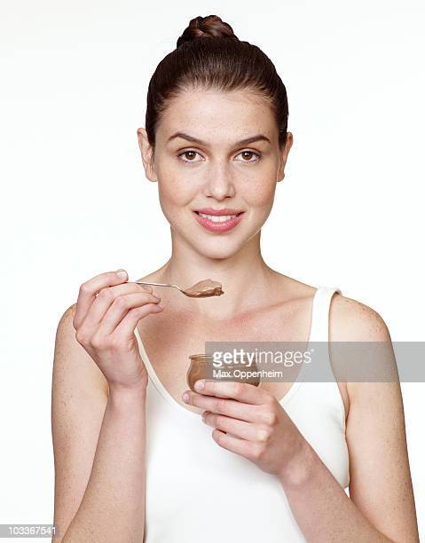 girl eating chocolate mousse