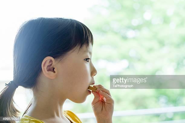 Girl eating cookie
