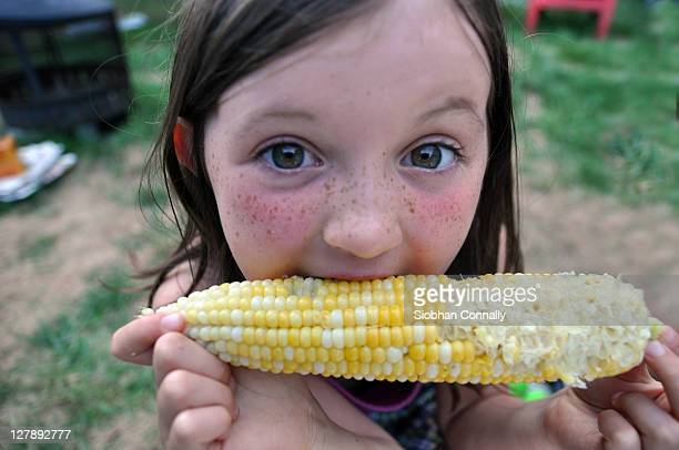 girl eating corn at fair - chatham new york state stock pictures, royalty-free photos & images