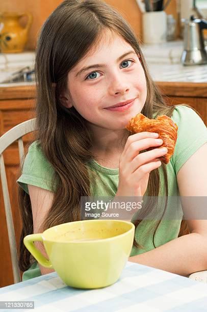 Girl eating croissant