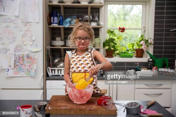 Girl eating from bowl