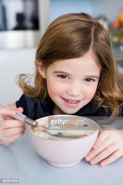 Girl eating fruit and yogurt