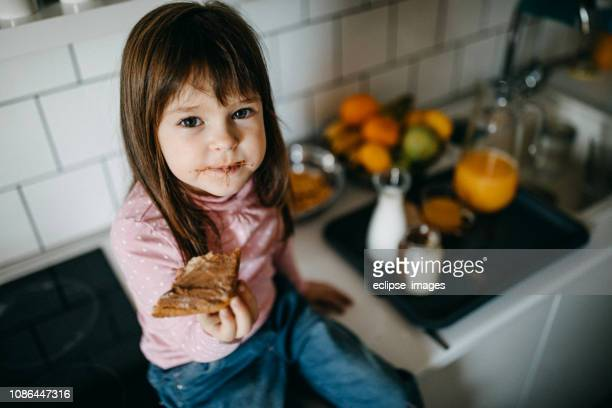 girl eating hazelnut cream - nutella stock pictures, royalty-free photos & images