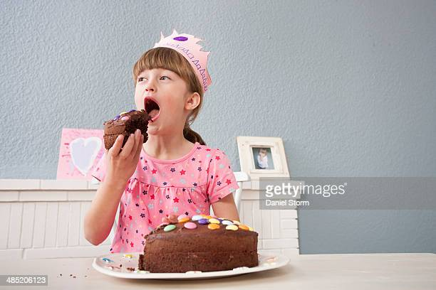 girl eating her birthday cake - happybirthdaycrown stock pictures, royalty-free photos & images