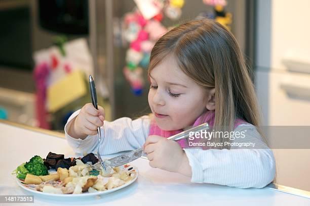 girl eating her dinner - berkshire england stock-fotos und bilder