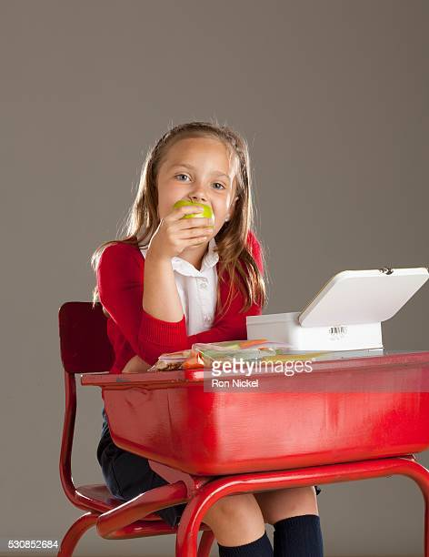 A Girl Eating Her Lunch At Her Desk