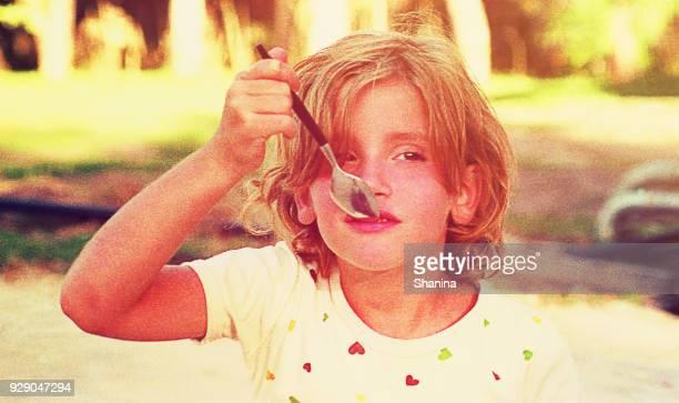 Girl eating ice cream outdoors