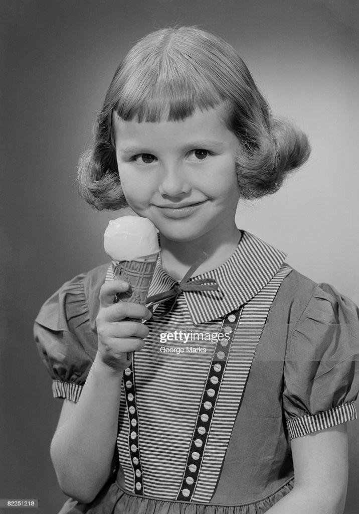 Girl (6-7) eating ice cream, portrait : Stock Photo