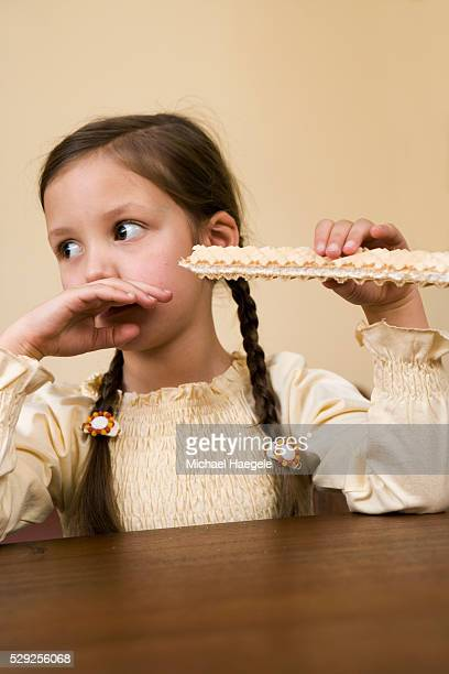 Girl Eating Large Wafer Cookie