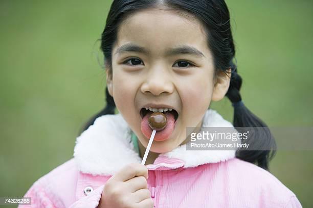 Girl eating lollipop