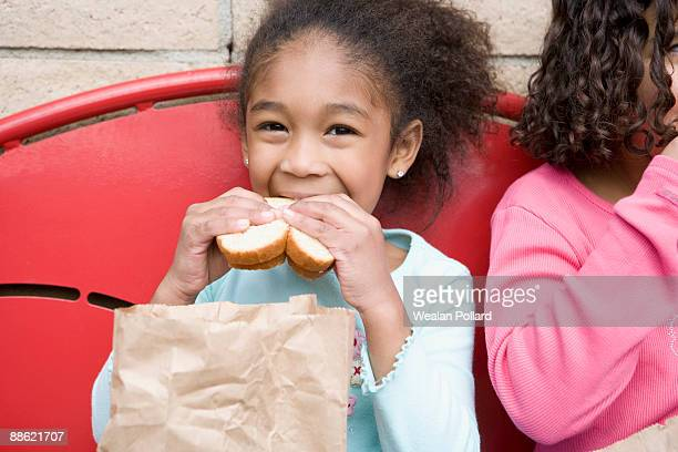 girl eating lunch at recess - lunch bag stock pictures, royalty-free photos & images