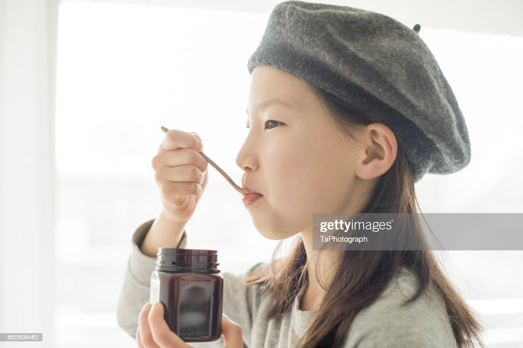 Girl Eating Manuka Honey : Stock Photo