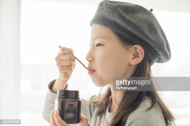 Girl Eating Manuka Honey
