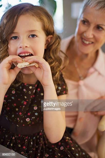 Girl eating matzoh