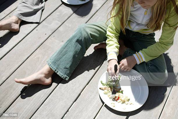 girl eating on porch - low section stock pictures, royalty-free photos & images