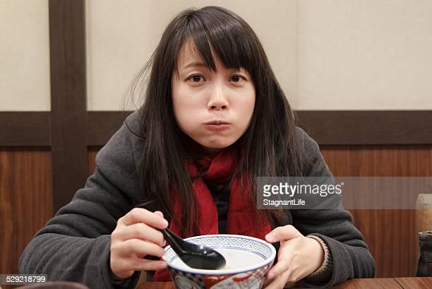 Girl eating puffy cheeks