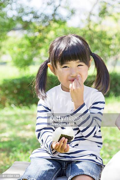 Girl Eating Rice Ball