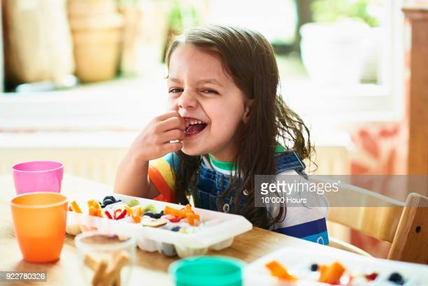 girl eating snacks - snack stock pictures, royalty-free photos & images