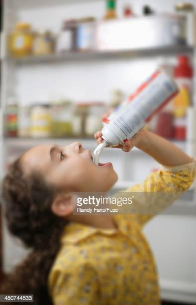 Girl Eating Whipped Cream from Can