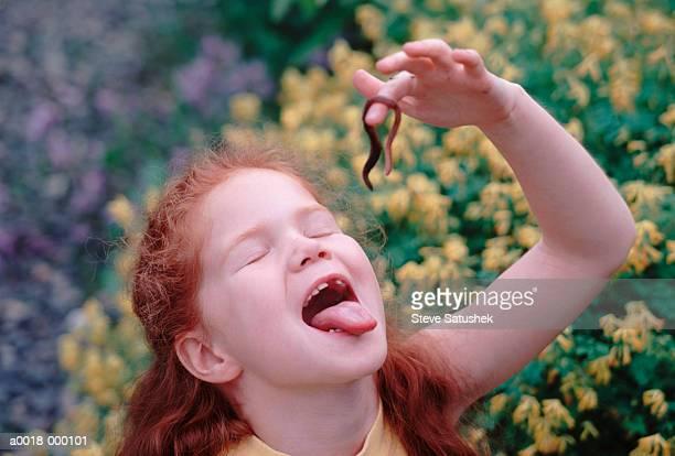 Girl Eating Worm