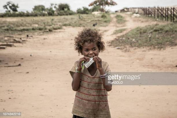 A girl eats a food supplement distributed during a malnutrition screening session organised by the NGO Action Contre la Faim and the World Food...
