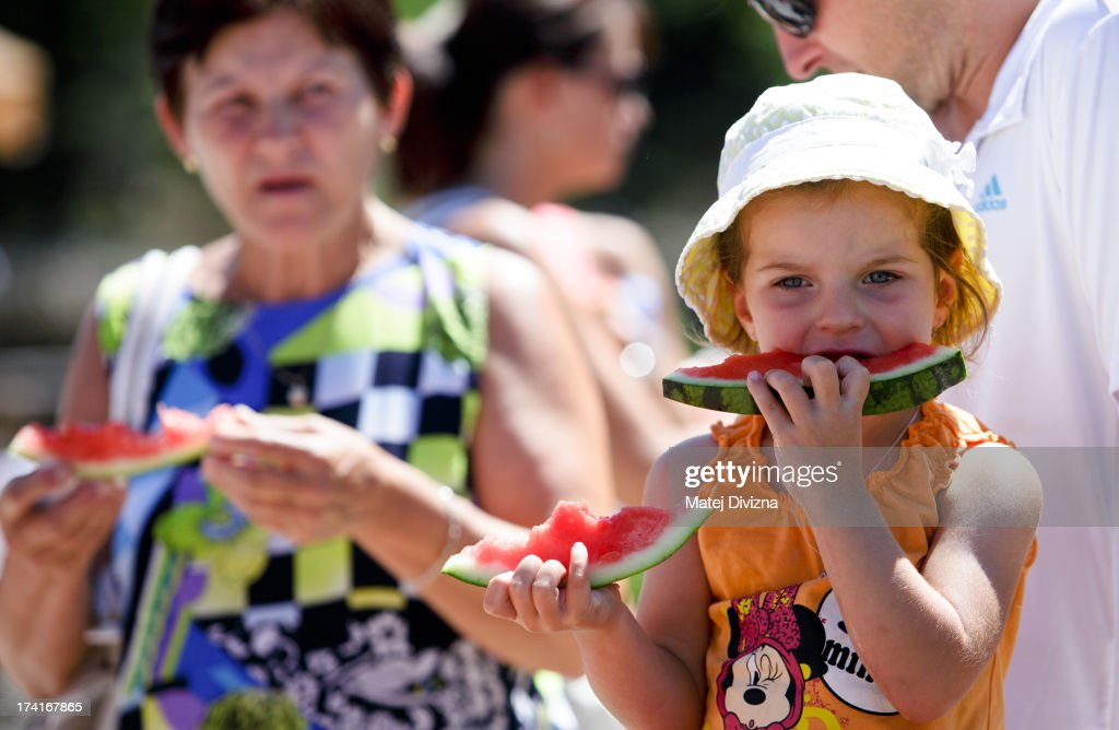 A girl eats watermelon during sunny day at Prague Zoo on July 21, 2013 in Prague, Czech Republic. This week was one of the driest weeks since 1951, according to Czech meteorologists.