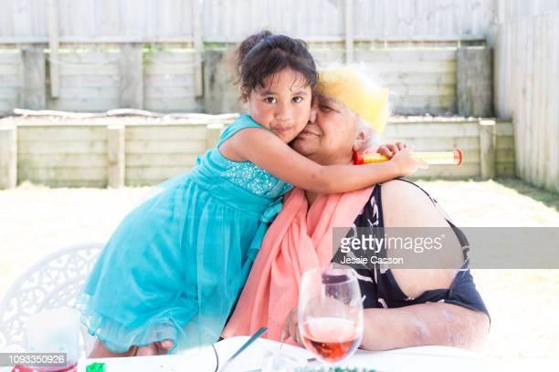 Girl embraces grandmother