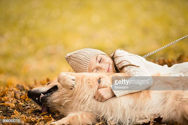 Girl embracing dog in the park