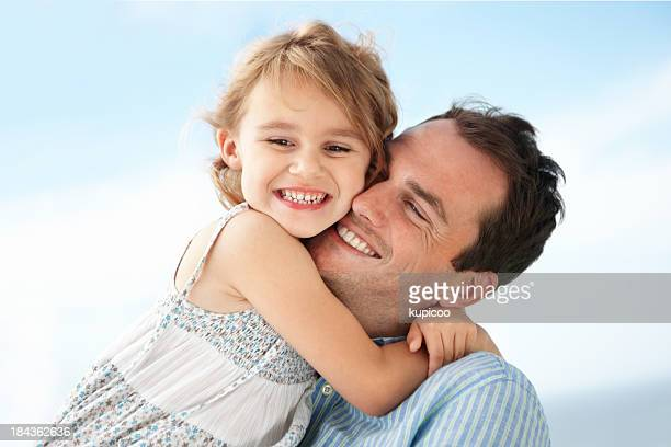 Girl embracing father