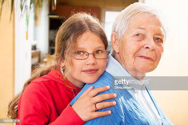 girl embracing great grandmother - great grandmother stock pictures, royalty-free photos & images