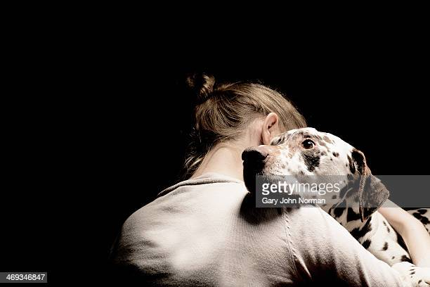 girl embracing her dog, studio shot - love stock pictures, royalty-free photos & images