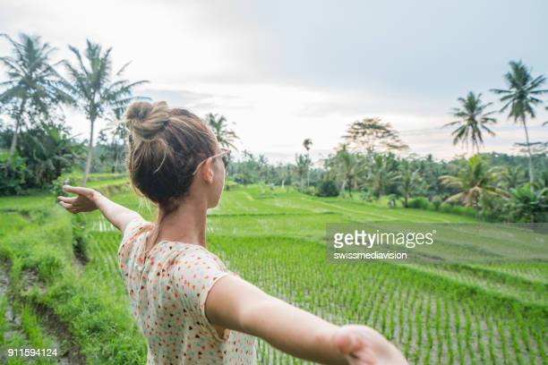 Girl embracing nature, rice field