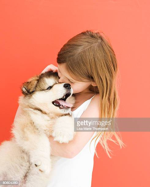 Girl embracing puppy