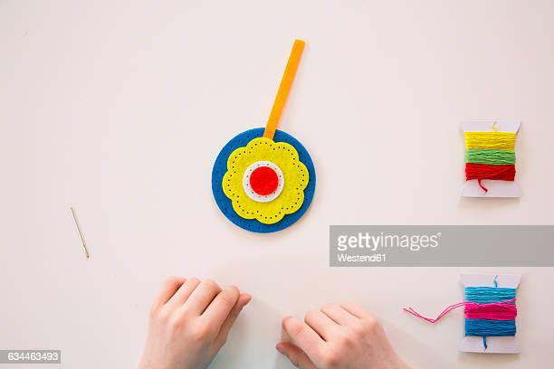 Girl embroidering, felt, decoration