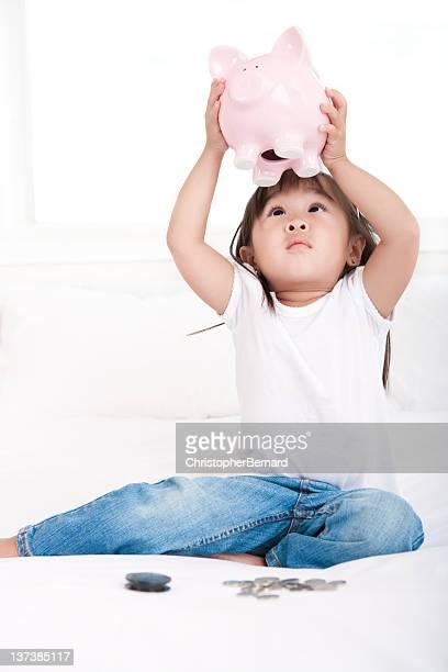 Girl empty piggy bank