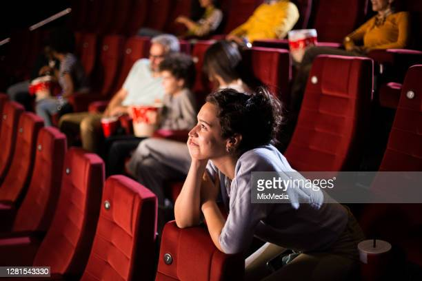 girl enjoying a movie at the cinema - film premiere stock pictures, royalty-free photos & images