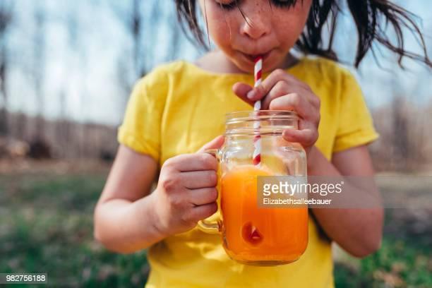 girl enjoying a summer drink - kaltes getränk stock-fotos und bilder