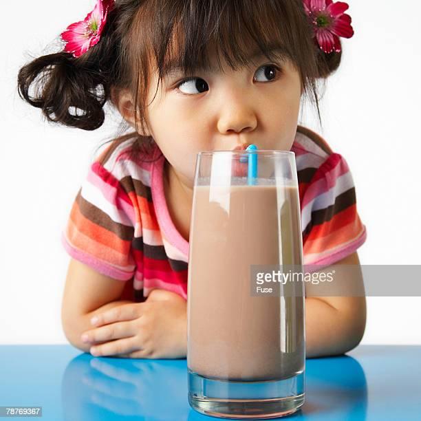 Girl Enjoying Chocolate Milk