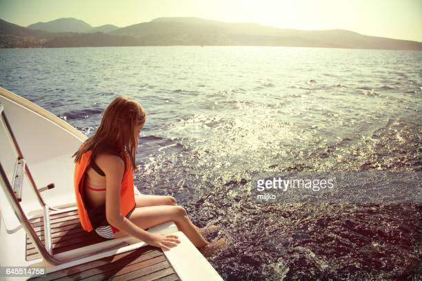 Girl enjoying her vacation on sailboat