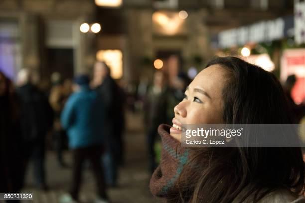 Girl enjoying light show on streets - Outdoor Christmas