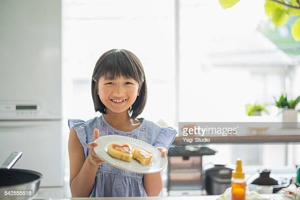 girl enjoying make a hot cake - japanese girls hot stock photos and pictures