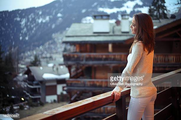 Girl enjoying mountains from balcony
